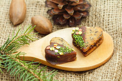 Doces do Natal em uma colher de madeira Imagens de Stock