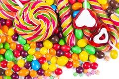 Doces e pirulitos coloridos Fotografia de Stock
