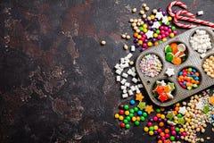 Doces e pirulitos coloridos Imagens de Stock
