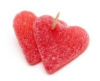 Doces Heart-shaped anexados por um toothpick imagens de stock