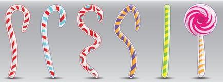 Doces listrados do Natal sob a forma das hastes e dos squiggles Imagens de Stock Royalty Free