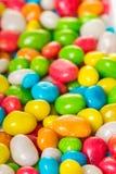 Doces redondos no esmalte colorido Fotografia de Stock