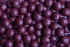 Doces roxos revestidos Fotografia de Stock Royalty Free