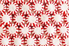 Doces vermelhos e brancos coloridos da luz das estrelas Imagens de Stock Royalty Free