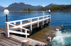 Dock. A beatiful view of a dock in the middle of the mountains with blue water Royalty Free Stock Image