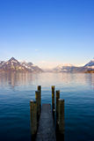 Dock. Empty dock in calm lake with mountains in the horizon. Buochs, Switzerland Royalty Free Stock Photo