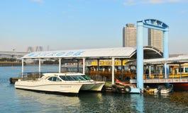Dock. Tokyo, Japan - 2 January, 2012: Tokyo Bay Trekker transporting tourists anchors at dock in Daiba district Royalty Free Stock Photo