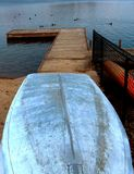 Dock. A boat sitting upside down in front of a dock Stock Photo