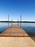 Dock. Looking over a lake with a clear blue sky Stock Photo