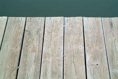 Dock. Wood planks of dock and a leaf stock image