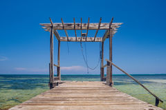 Dock against a blue sky Royalty Free Stock Images