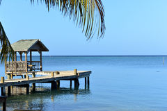 Dock along the Caribbean Ocean, Roatan, Honduras Stock Photo