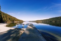Dock Along the Shore Under Blue and White Cloud Sky during Daytime Royalty Free Stock Images