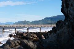 Dock on beach stock photos