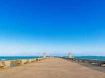 Dock with beach on summer Stock Photos