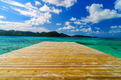 Dock and Beautiful Water. Wooden dock extending out into beautiful turquoise water in San Andres y Providencia, Colombia Stock Image