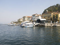 Dock of Bellagio with nineteenth-century historic homes Stock Images