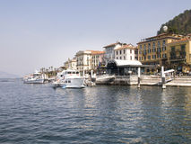 Dock of Bellagio with nineteenth-century historic homes Stock Photography