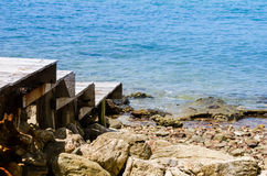 Dock and blue sea Royalty Free Stock Photo