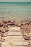 Dock and blue sea vintage Royalty Free Stock Image