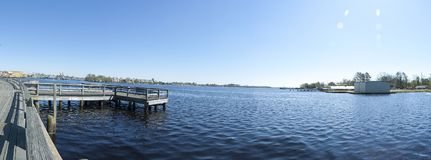 Dock in blue water royalty free stock photo