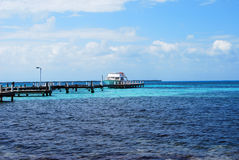 Dock with a Boat in the Ocean Royalty Free Stock Photo