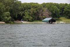 A Dock and a Boat Shelter on a Lake Royalty Free Stock Photography