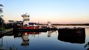 Tugboats water mirror image stock photo