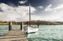 dock and boat typical of the Balearic islands Royalty Free Stock Images
