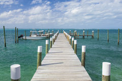 Dock and boats in bahamas Royalty Free Stock Photos