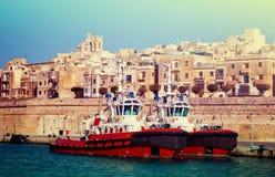 Dock boats. In Grand Harbour (Valletta, Malta Stock Photography