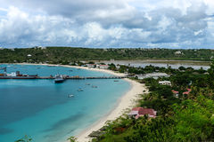 Dock and brackish pond, Anguilla, British West Indies, BWI, Caribbean. Divide between ocean and brackish pond in Anguilla, British West Indies, BWI, Caribbean Royalty Free Stock Images