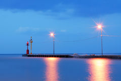 Dock with calm blue sea. Dock with calm sea and blue lights after the sunset Royalty Free Stock Image