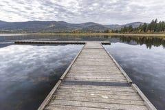Dock on calm Idaho lake. stock photo