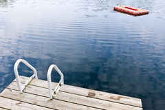 Dock on calm summer lake Stock Image