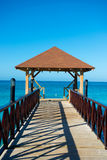 Dock with canopy stretching into the sea. Wooden pontoon. Dock with canopy stretching into the sea Stock Images