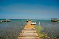 Dock caye caulker belize. Wooden pier dock jetty relaxing ocean view caye caulker belize caribbean stock images