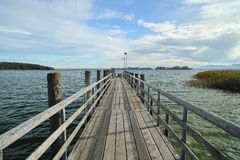 Dock on Chiemsee lake. Chiemsee lake in Bavaria, Germany in octomber 2011 morning at sunrise Royalty Free Stock Image