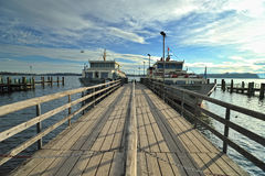 Dock at Chiemsee lake at sunries Royalty Free Stock Photos