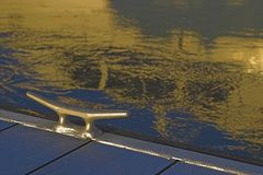 Dock Cleat and Reflection. Marina Dock Cleat with Boat reflection in water Stock Photography