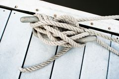 Dock cleat and rope Royalty Free Stock Photo
