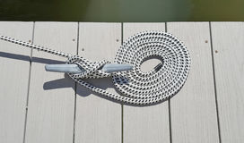 Dock cleat with rope Royalty Free Stock Photo