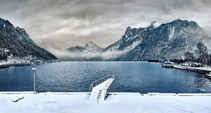 Dock Covered With Snow Near Lake Royalty Free Stock Photography