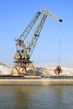Dock crane. Loading gravel into barges Stock Photos