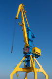 Dock crane in the port. Yellow- blue dock crane in the port Stock Images