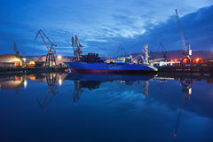 Dock with cranes and ship at night Stock Image