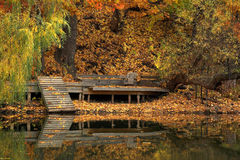 Dock on creek in fall. Autumn view of dock in creek Royalty Free Stock Photos