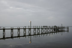 Dock at Dawn on a Cloudy Day royalty free stock images