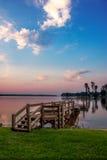 Dock de Muray de lac au lever de soleil Image libre de droits