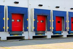 Dock doors. Loading dock cargo doors at big warehouse stock photography
